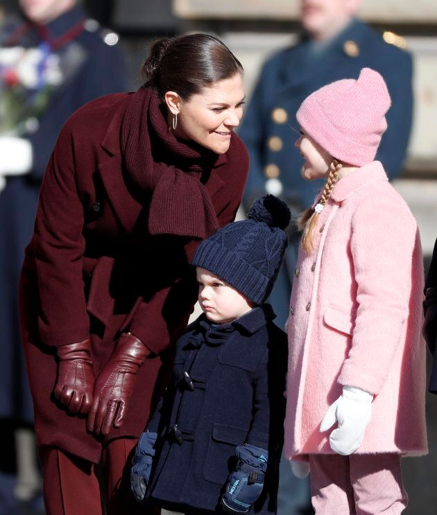 Princess Estelle of Sweden, probably telling her mother that she would happily accept some candy, as wee Prince Oscar endures horrifying potty training flashbacks.
