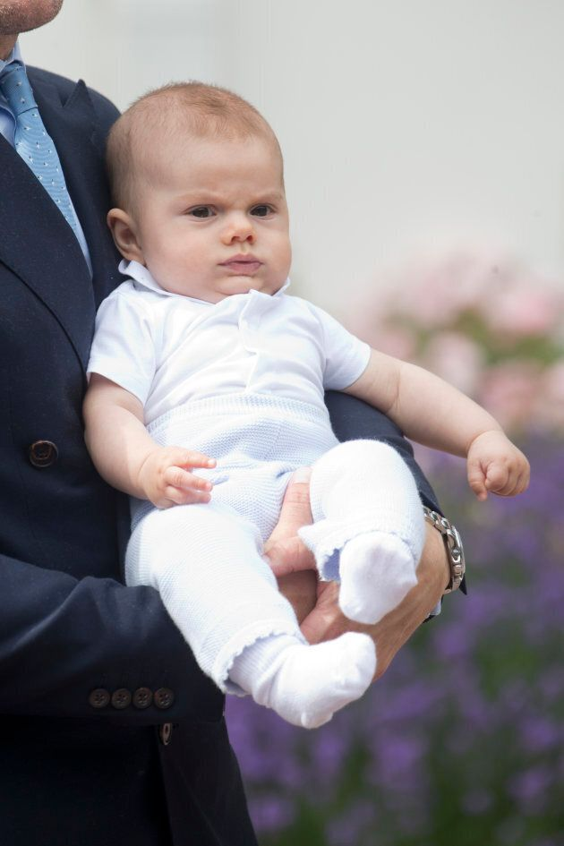 Prince Oscar of Sweden, daring you to tell him he's too young for cake, at Crown Princess Victoria of...