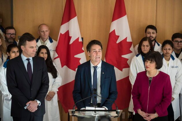 Finance Minister Bill Morneau, Dr. Eric Hoskins, Chair of the Advisory Council on the Implementation...
