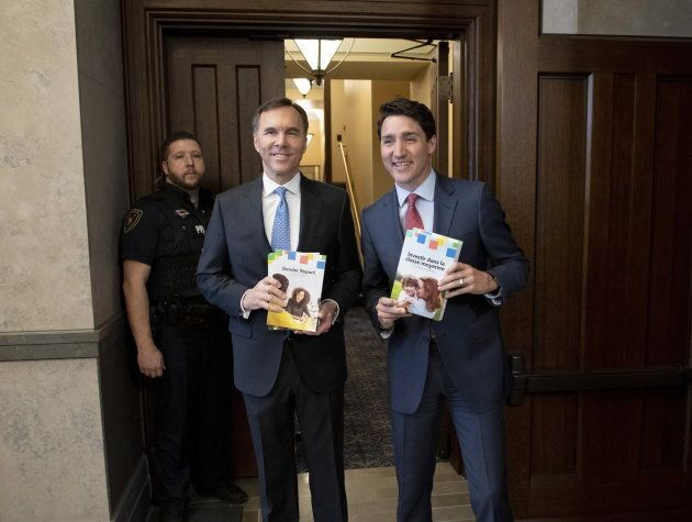 Prime Minister Justin Trudeau and Minister of Finance Bill Morneau arrive in the Foyer of the House of...