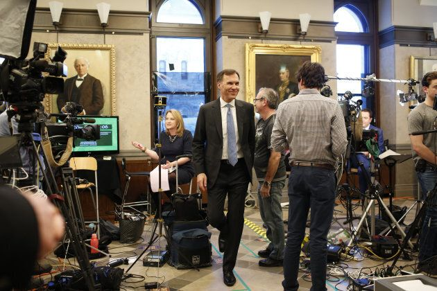 Bill Morneau smiles as he departs a television interview after tabling the federal budget in Ottawa on...