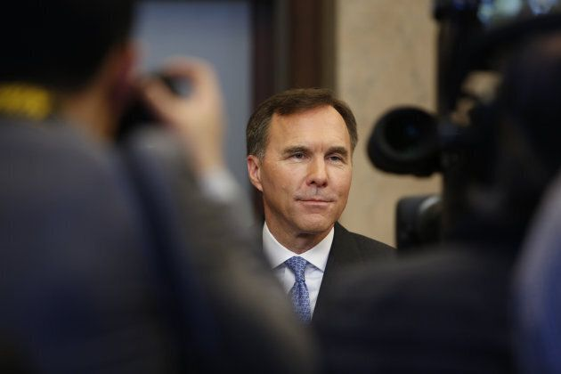 Finance Minister Bill Morneau speaks to members of the media after tabling the federal budget in Ottawa on March 19, 2019.