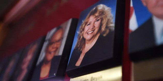 A picture of Senator Lynn Beyak accompanies other Senators official portraits on a display outside the...