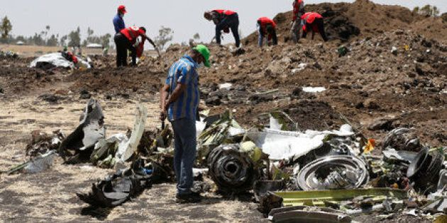 A man watches debris at the scene of the Ethiopian Airlines Flight ET 302 plane crash, near the town...