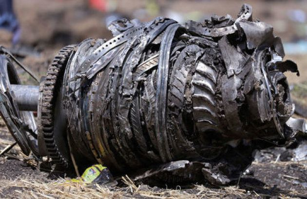 Airplane engine parts are seen at the scene of the Ethiopian Airlines Flight ET 302 plane crash, near...