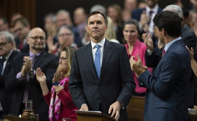 Prime Minister Justin Trudeau and MPs applaud as Finance Minister William Morneau rises to deliver the...