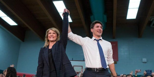 Prime Minister Justin Trudeau and Tamara Taggart speak to supporters at a Liberal nomination event in...