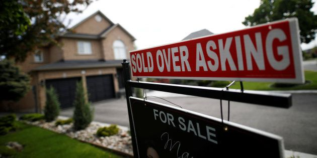 A real estate sign in front a house in Vaughan, near Toronto, May 24,