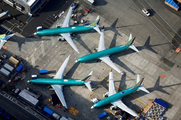 An aerial photo shows Boeing 737 MAX airplanes parked on the tarmac at the Boeing Factory in Renton,...