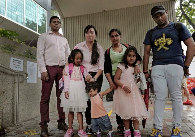 Asylum seekers, from left: Ajith Pushpa Kumara, Vanessa Mae Rodel and her daughter Keana, Nadeeka Dilrukshi...