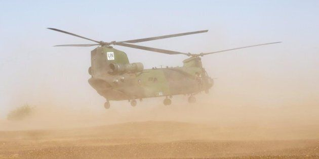 A Canadian Chinook helicopter takes off as it provides logistical support during a demonstration on the...