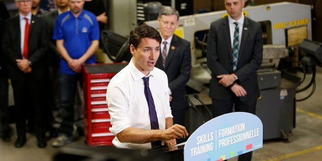 Prime Minister Justin Trudeau talks to media after meeting with students and teachers at Manitoba Institute...