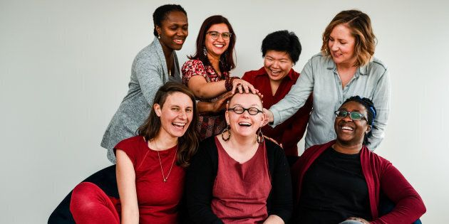 Calgary's Red Community Midwives, from left to right: Maryam Gjerde, Annegret Ebermann, Luisa Franco, Erin Laing (center, with hands on her head), Nancy Tsao, Lindsay Vanderburg, and Babil Pobee.
