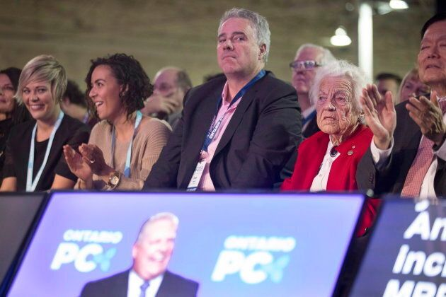 Dean French, centre, chief of staff to Ontario Premier Doug Ford, listens to the premier speak at the Progressive Conservative party convention in Toronto on Nov. 16, 2018.
