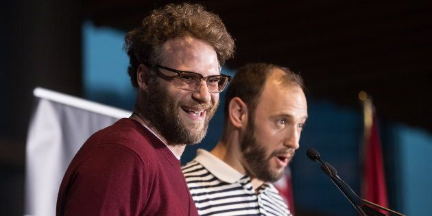 Seth Rogen, left, laughs as Evan Goldberg speaks during a Canada's Walk of Fame ceremony honouring them...