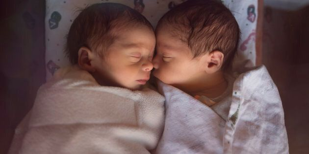 These newborn premature male fraternal twins have a better chance of surviving these days compared to...