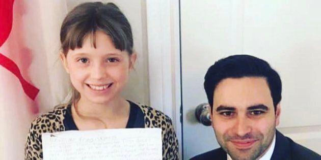 Greta Fleet proudly holding her letter with her MP Peter Fragiskatos.