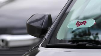 SAN FRANCISCO, CALIFORNIA - MARCH 7: The Lyft logo is displayed on a car on March 7, 2019 in San Francisco, California. On-demand transportation company Lyft has filed paperwork for its initial public offering that is expected to value the company at up to $25 billion. (Photo by Justin Sullivan/Getty Images)