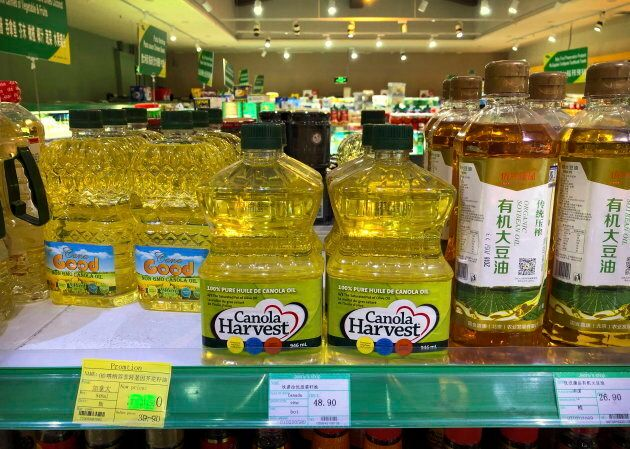 Bottles of Canadian-manufactured canola oil, centre, seen on a shelf of a grocery store in