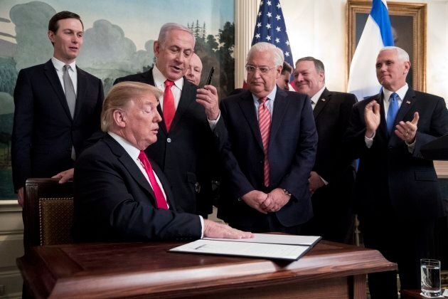 Prime Minister of Israel Benjamin Netanyahu holds up the pen used by US President Donald J. Trump to...