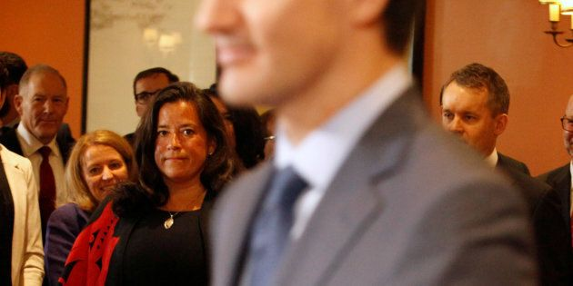 Jody Wilson-Raybould watches Prime Minister Justin Trudeau arrive at Rideau Hall of a cabinet shuffle...
