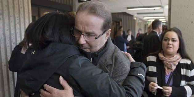 Glen Assoun is embraced by family members at Nova Scotia Supreme Court in Halifax on March 1,