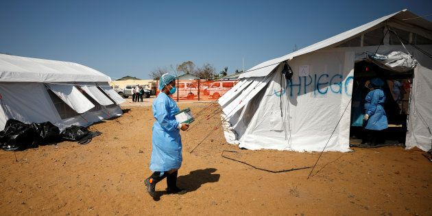Medical staff wear protective masks at a cholera treatment centre set up in the aftermath of Cyclone...