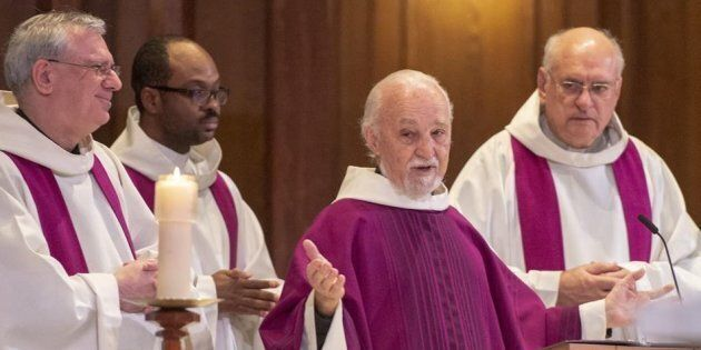 Father Claude Grou, second from right, celebrates mass at St. Joseph's Oratory on