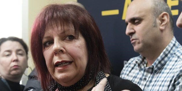 Lynda Poirier of the suicide prevention centre responds to reporters questions as taxi industry spokesperson...