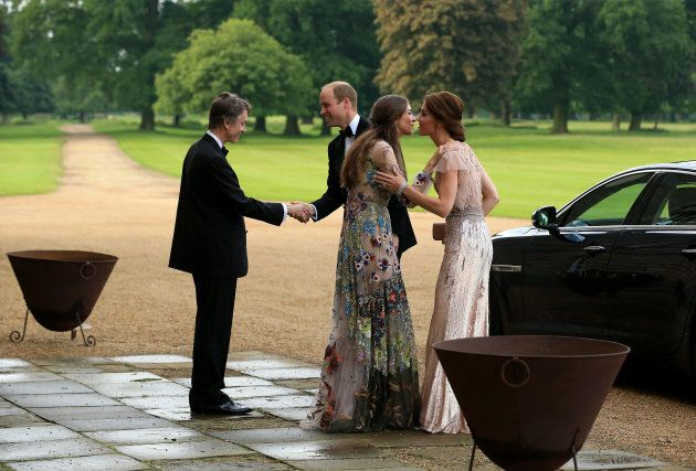 Prince William and Catherine, Duchess of Cambridge are greeted by David Cholmondeley, Marquess of Cholmondeley...