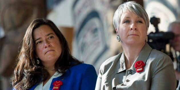 Left to right: Jody Wilson-Raybould, Patty Hajdu and Carolyn Bennett listen during the announcement of...