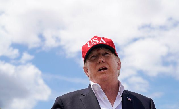 U.S. President Donald Trump speaks to reporters during the president's visit to Lake Okechobee and the...