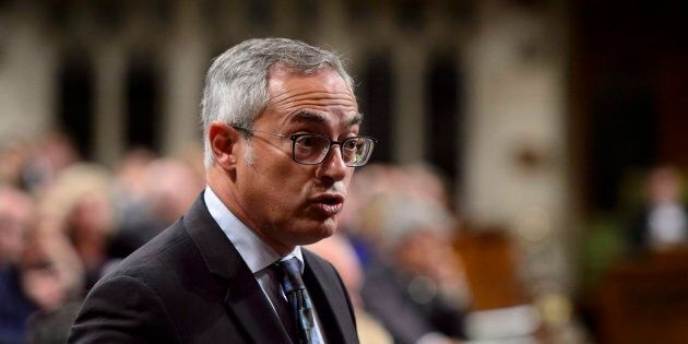 Conservative MP Tony Clement stands during question period in the House of Commons on Parliament Hill...