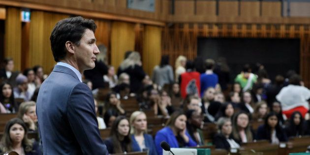 Canada's Prime Minister Justin Trudeau listens to a question during the Daughters of the Vote event in...