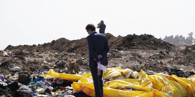 A United States Government official inspects the crash site of Ethiopian Airlines Flight ET 302 on March...