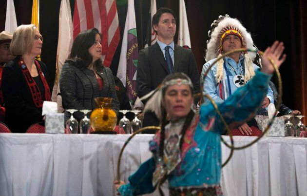 A hoop dancer performs as then-Indigenous Affairs minister Carolyn Bennett, Jody Wilson-Raybould, Prime Minister Justin Trudeau and AFN National Chief Perry Bellegarde take their places on stage at the Assembly of First Nations Special Chiefs Assembly in Gatineau, on Dec. 8, 2015.