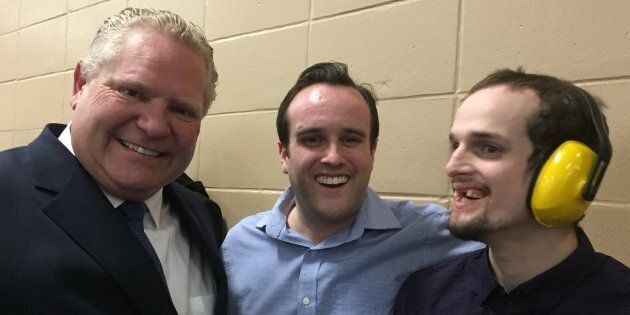 Ontario Premier Doug Ford poses for a photo with Ottawa-West-Nepean MPP Jeremy Roberts and his brother...