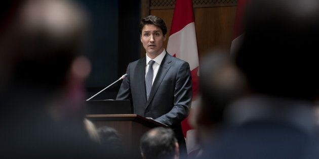 Prime Minister Justin Trudeau speaks at a caucus meeting on Parliament Hill in Ottawa on April 2,