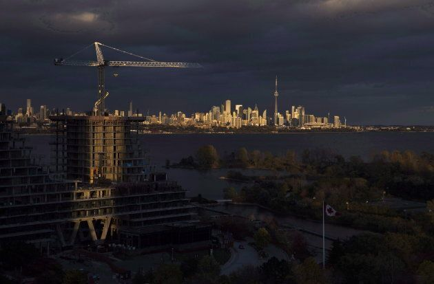 Condominiums are seen under construction in front of the skyline in Toronto on Oct. 31,