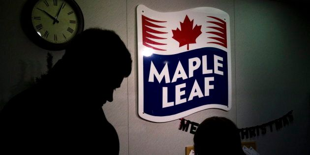 A Maple Leaf Foods employee and a representative of the media at the company's meat facility in Toronto,...