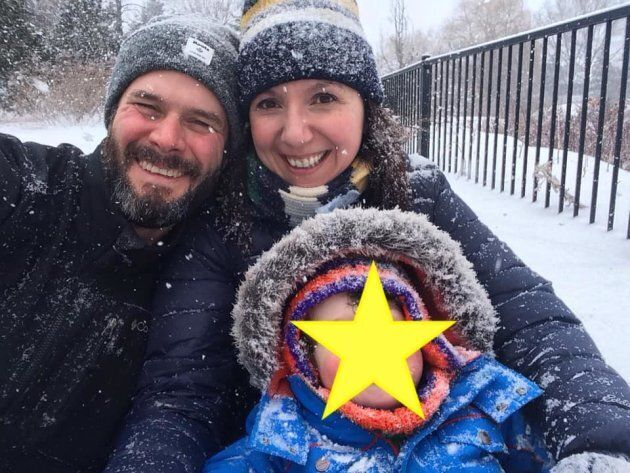 Natalie Stechyson and her husband enjoying a sled ride with their son. This was taken in Ottawa, so it's...