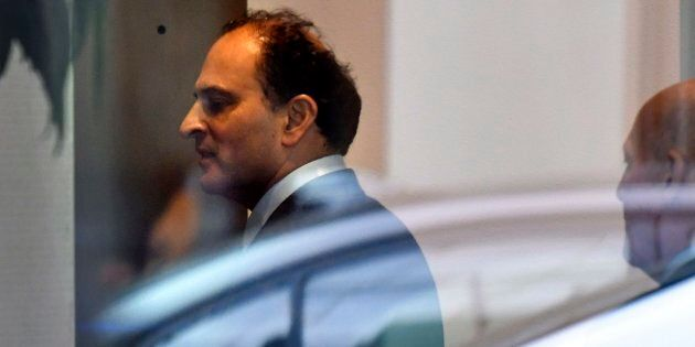 Vancouver businessman David Sidoo enters an adjacent building with his lawyer following a federal court...