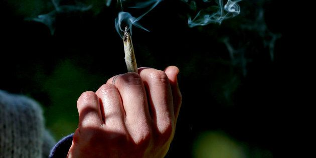 A woman holds a joint on the day Canada became the first developed nation to legalize recreational marijuana,...