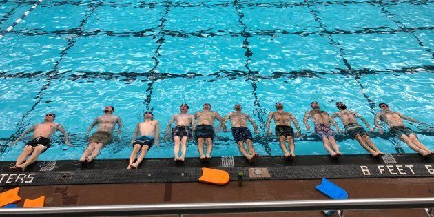 Aquatica Synchro Men's Team, which is made up of dads and husbands of female athletes, during a practice in Winnipeg.