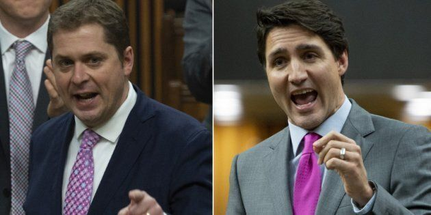 Conservative Leader Andrew Scheer and Prime Minister Justin Trudeau speak during question period in the House of Common on April 10, 2019.