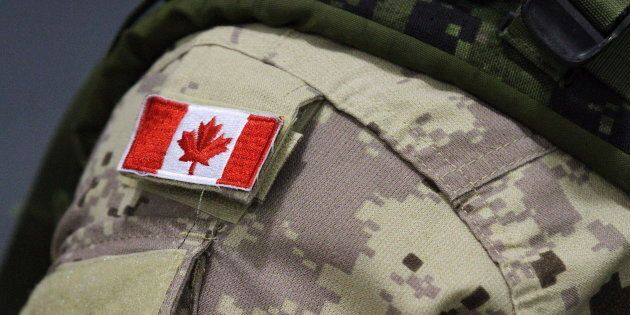 A Canadian flag patch is shown on a soldier's shoulder in Trenton, Ont. on, Oct. 16,