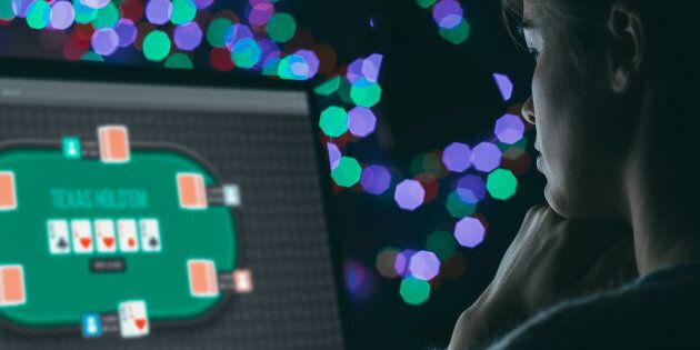 A woman plays an online gambling game in a stock photo. The Ontario government announced it plans to legalize online gambling in its 2019 budget.