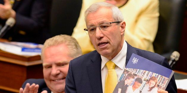 Ontario Finance Minister Vic Fedeli presents the 2019 budget as Premier Doug Ford looks on at the legislature in Toronto on April 11, 2019.
