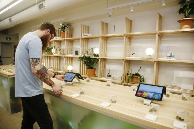 An employee uses a tablet to search for products during a media preview event at the HOBO Recreational...
