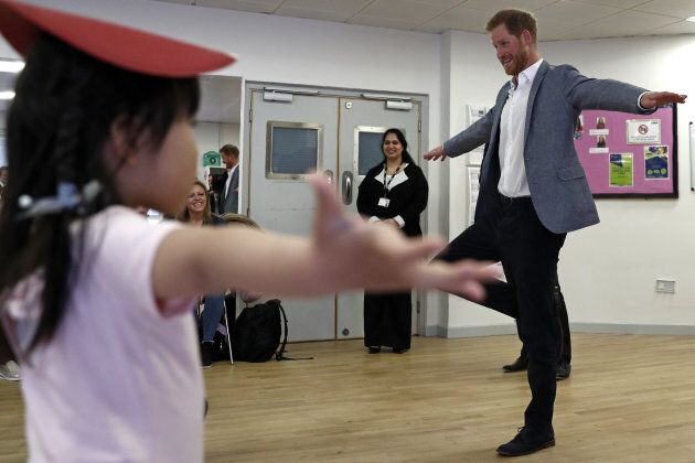 Prince Harry, Duke of Sussex joins children taking part in ballet class for 4 to 6 year olds, during...
